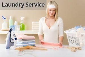Laundry ironing - woman folding clothes